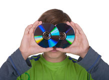 Teenager holds a computer disk for record. On a white background Royalty Free Stock Photo