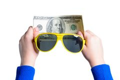 A teenager holds one hundred dollars with two hands and sunglasses royalty free stock photo