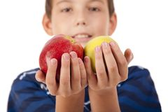 The teenager  holds two apples Royalty Free Stock Images