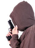 Teenager in the hood with gun. Royalty Free Stock Photos