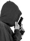 Teenager in the hood with gun. Black and white tone Royalty Free Stock Photo