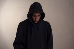 Teenager with hoodie looking down Royalty Free Stock Photo