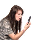 Teenager horrified by phone Stock Photo