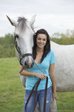 Teenager and horse Stock Image