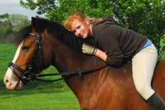 Teenager  and horse Stock Images