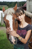 Teenager with horse stock photo