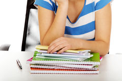 Teenager with huge heap of copybooks Royalty Free Stock Photography