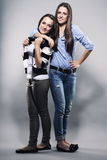 Teenager Hugging Her Sister Stock Images