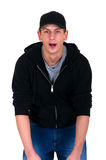 Teenager humor face. Handsome teenager in leisure clothing making funny faces and gestures.  Studio, white background Royalty Free Stock Photography