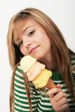 Teenager with ice cream cone. Young woman wearing a green striped sweater having ice cream cone Stock Image