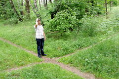 Teenager In Forest By Crossroad Choose The Path Royalty Free Stock Photo