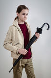 Teenager in jacket with umdrella Stock Image