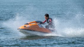Teenager on Jet Ski-Water Sports in the summer having fun on the beach stock photo