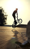 Teenager jump on bicycle outdoors, boy on skateboard, urban styl Royalty Free Stock Images
