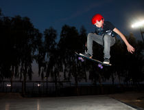 A teenager jump. A teenager doing some skateboard jumps with a skateboard at Kfar-Sava skate park Stock Photography