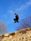 Teenager jumped from steep Royalty Free Stock Photo