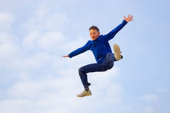 Teenager jumping against the sky. Parkour Stock Photos