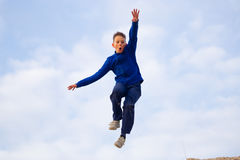 Teenager jumping against the sky. Parkour Stock Images