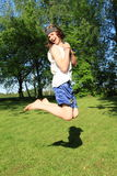 Teenager jumping on meadow Stock Photography