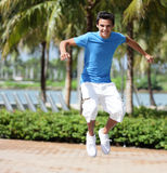 Teenager jumping in the park Royalty Free Stock Photo