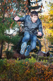 Teenager jumps over bushes Stock Photo