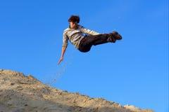 Teenager karate-style kick Stock Photos