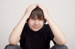 Teenager keeps head thinks about problems Royalty Free Stock Photography