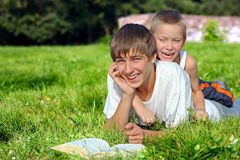 Teenager And Kid In The Park Royalty Free Stock Image