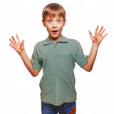 Teenager kids boy raised his hands up baby. Boy surprised isolated emotion Royalty Free Stock Image