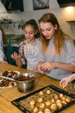 Teenager kids team cooking having fun. Moscow, Russia, November 21, 2017: Unidentified teenager kids cooking pasta on culinary master class - happy event Royalty Free Stock Photos
