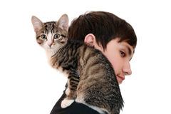 Teenager with a kitten (focus on the animal) Stock Images