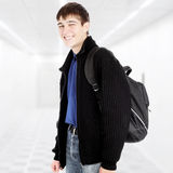 Teenager with Knapsack. Cheerful Teenager with Knapsack in the White Corridor Royalty Free Stock Image