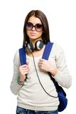 Teenager with knapsack and headphones. Teenager with knapsack and earphones wearing black sunglasses, isolated on white Royalty Free Stock Photography