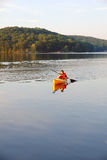 Teenager at the lake. In a kayak, late afternoon Stock Photo