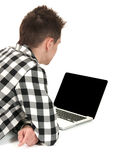Teenager on a laptop. A teenage student using a laptop computer with blank screen Royalty Free Stock Photography