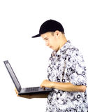 Teenager with laptop. Isolated in a white background Stock Photos