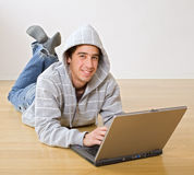Teenager and laptop computer Stock Photography