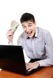 Teenager with Laptop and Money Stock Image