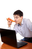 Teenager with Laptop and Pizza Royalty Free Stock Image