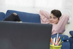 Teenager with the laptop royalty free stock images