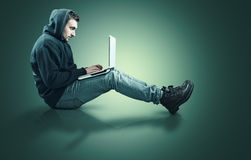 Teenager and laptop Royalty Free Stock Images