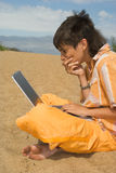 The teenager  with laptops Royalty Free Stock Photo
