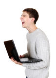 Teenager laughing with Laptop Stock Photography