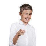 Teenager laughing, pointing with finger at someone. Portrait happy young man, teenager laughing, pointing with finger at someone, something, isolated white Stock Photos