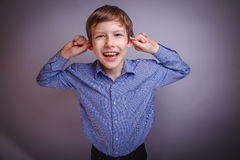 Teenager laughing pulling her ears Royalty Free Stock Photos
