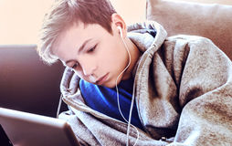 Teenager lay on the floor in the room Royalty Free Stock Photography