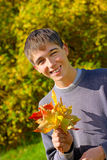Teenager with leafs Stock Photography