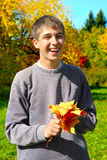Teenager with leafs Stock Photo