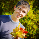 Teenager with Leafs Royalty Free Stock Image