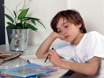 Teenager learning. Boring Teenager learning for school Royalty Free Stock Photography